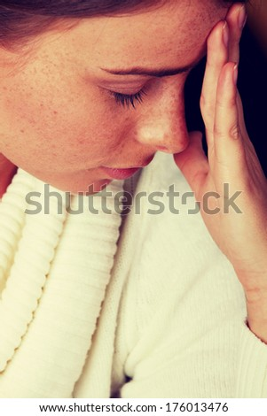 Woman with a big headache - stock photo
