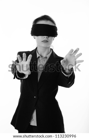 woman with a blind fold on so she can not see where she is going