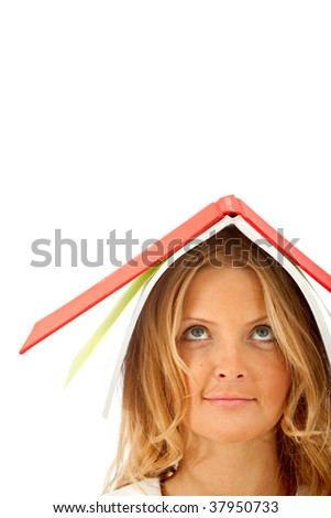 Woman with a book on her head isolated - stock photo