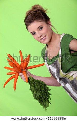 Woman with a bunch of carrots - stock photo