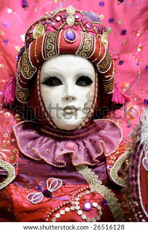 Woman with a carnival mask which looks like a doll (Annecy/France) - stock photo