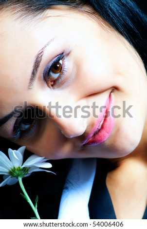 woman with a chrysanthemum - stock photo