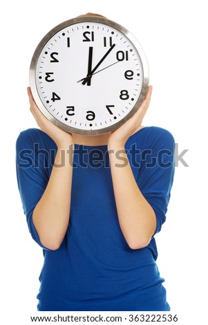 Woman with a clock.
