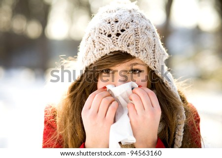 Woman with a cold - stock photo
