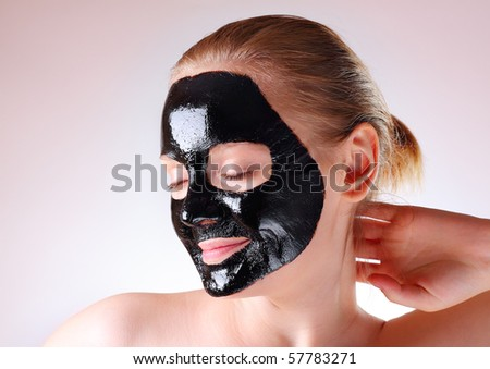 Woman with a face mask - stock photo