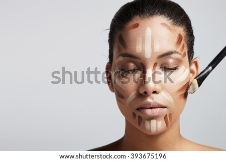 woman with a facial corrector  - stock photo