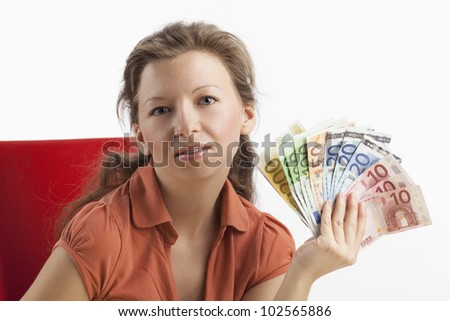 Woman with a fan made ??of paper money in her hands - stock photo