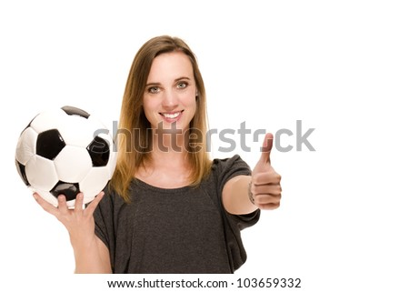 woman with a football showing thumbs up on white background - stock photo