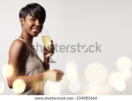 woman with a glass of champagne, bokeh on a background - stock photo