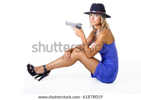 woman with a gun in her hand