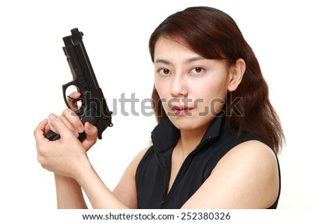 woman with a handgun - stock photo