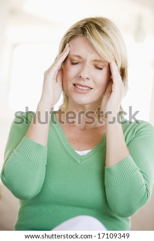 Woman With A Headache - stock photo