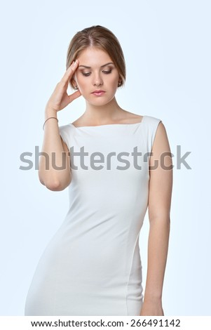 Woman with a headache holding head, isolated on white background - stock photo
