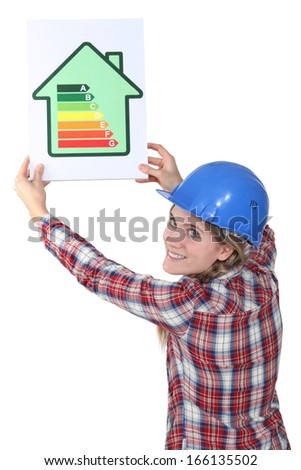 Woman with a house energy sign - stock photo