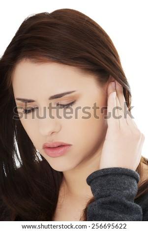 Woman with a huge headache - stock photo