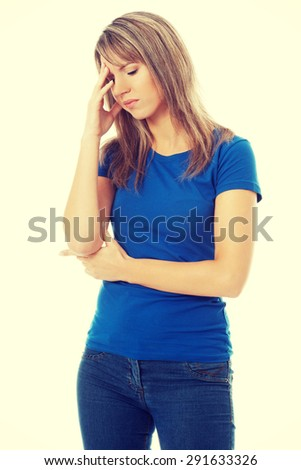 Woman with a huge headache - stock photo