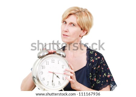 Woman with a large alarm clock - stock photo