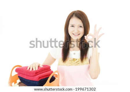 Woman with a laundry basket - stock photo