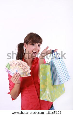 Woman with a lot of money and shopping bags - stock photo