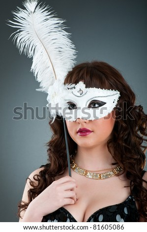 Woman with a mask in studio shooting - stock photo