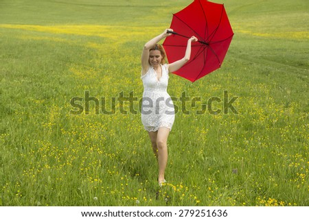 Woman with a red umbrella during a spring day
