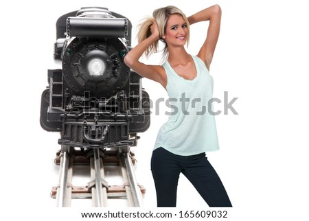 Woman with a replica of a steam powered train