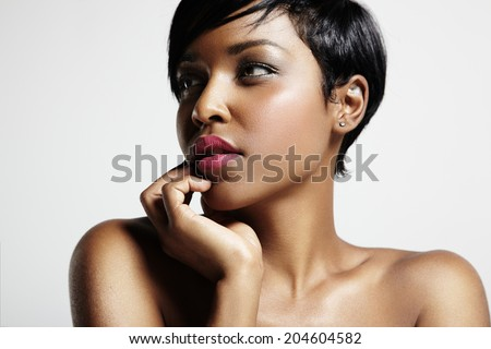 woman with a short haircut and black skin - stock photo