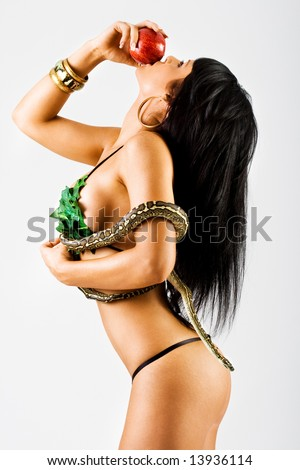 Woman with a snake eating red apple - stock photo