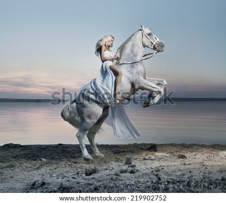 Woman with a white horse - stock photo