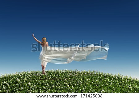 woman with a white tissue on the green grass