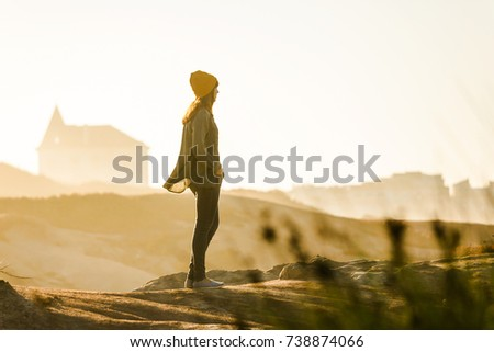Woman with a yellow cap enjoying the view