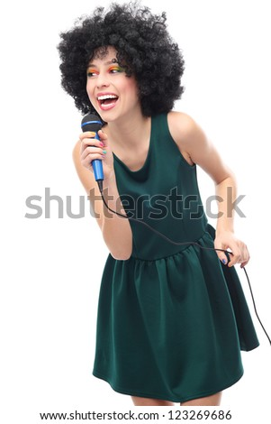 Woman with afro hairstyle holding microphone - stock photo