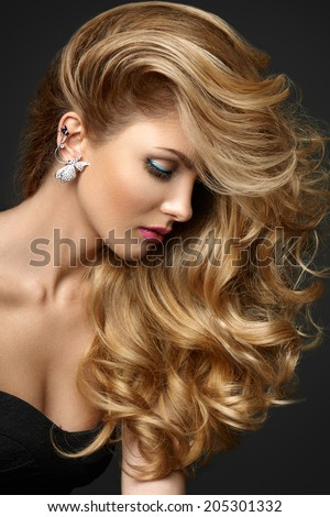 Woman with amazing hair on gray background