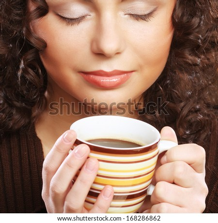 Woman with an aromatic coffee - stock photo