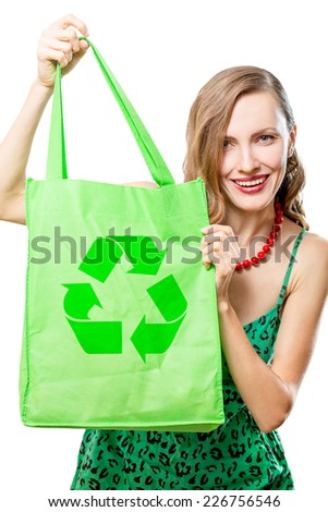 Woman with an ecological bag - isolated over a white background - stock photo