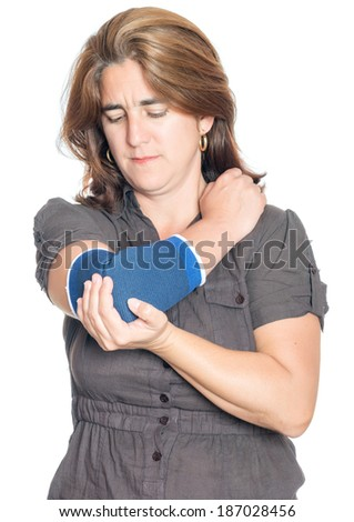 Woman with an injured painful arm elbow wearing a therapeutic elastic support band isolated on white - stock photo