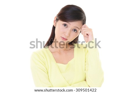 Woman with an uneasy look - stock photo