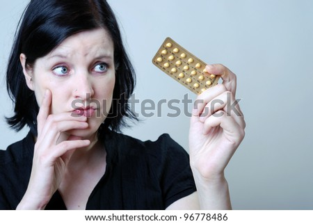 woman with anti-baby pill - stock photo