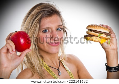 woman with apple and hamburger