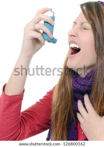 Woman with asthma using pump inhaler - stock photo
