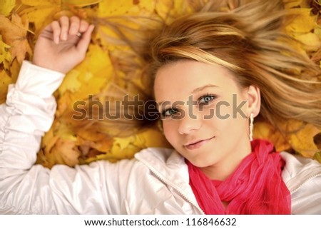 woman with autumn leaves - stock photo