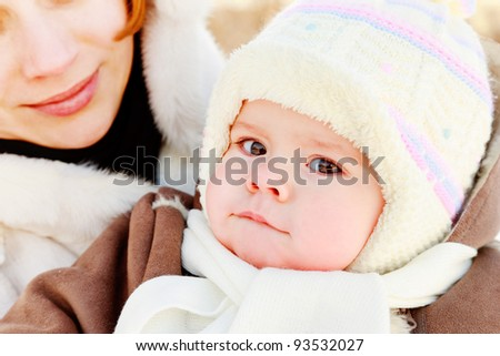 Woman with baby on her hand in winter