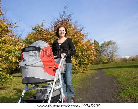 Woman with baby outdoor - stock photo