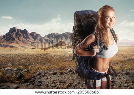 Woman with Backpack hiking in Mountains with beautiful summer landscape - stock photo