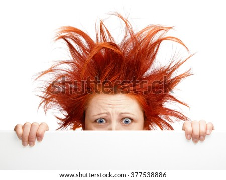 Woman with bad hair day isolated on white - stock photo