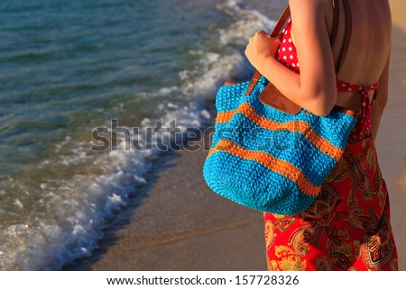 woman with beach bag at the sea, holiday concept  - stock photo
