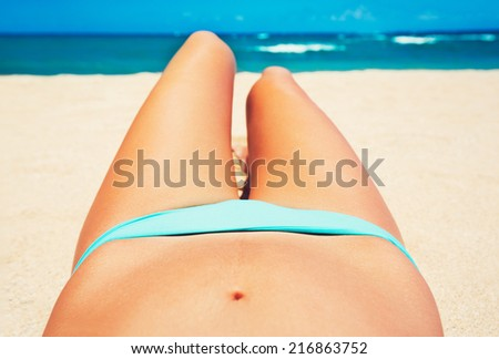 Woman with Beautiful Body on Topical Beach, Point of View Perspective Looking out at Ocean - stock photo