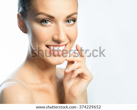 Woman with beautiful eyes, smiles broadly, showing all his teeth and a beautiful skin - stock photo