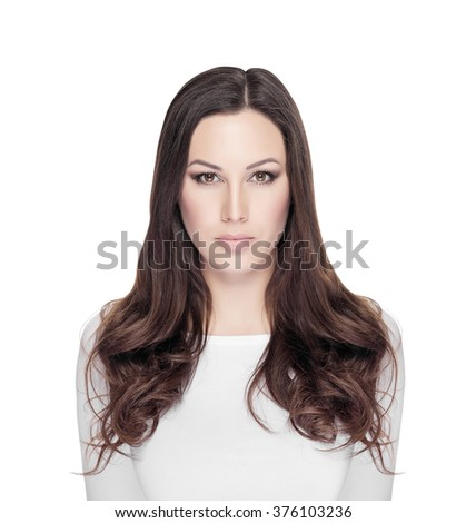 Woman with beautiful face and brown hair on white background. - stock photo