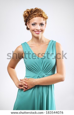 Woman with beautiful hairstyle on light background